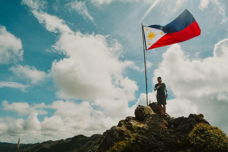 A proud filipino standing on the summit