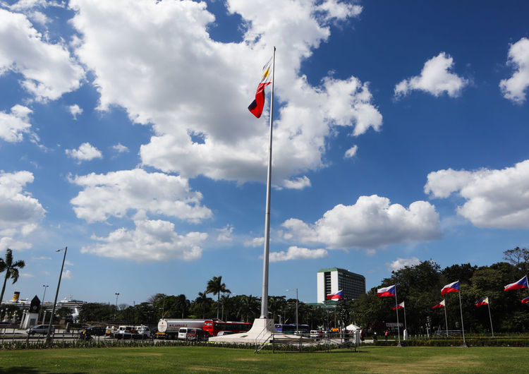 philippine flag Philippines Politics And Government Patriotism Flag Sky Cloud - Sky Grass Memorial National Icon Place Of Burial War Memorial Symbolism Monument National Flag Government Fluttering Flag Pole