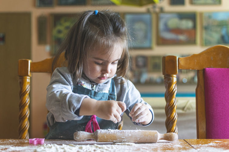Cute girl making cookie at home
