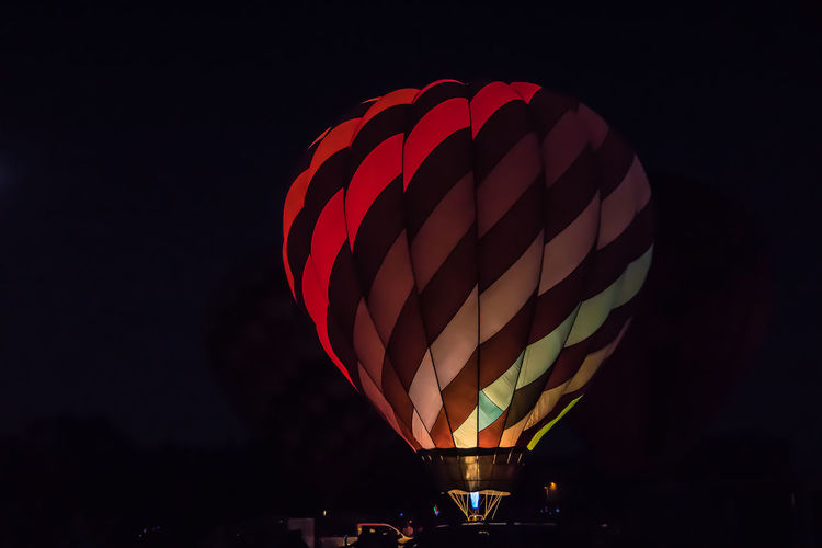 Low angle view of hot air balloon against sky at night