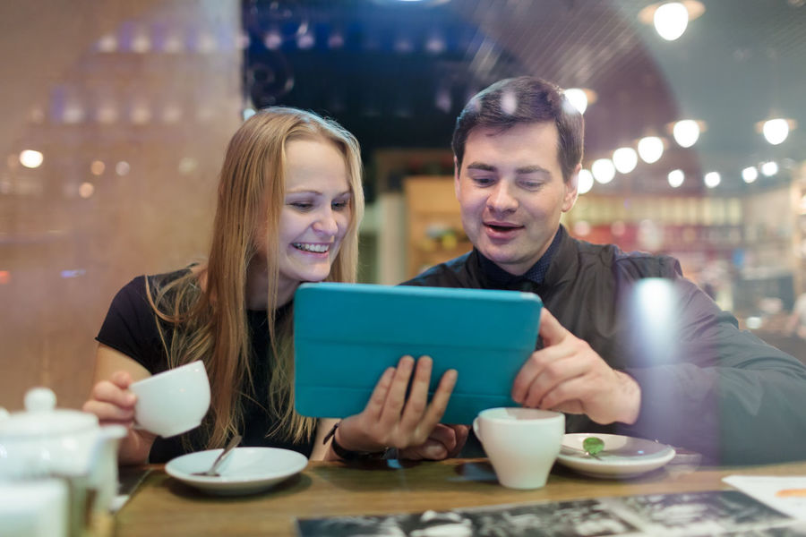 Businessman Businesspeople Cafe Cafeteria Caucasian Coffee Computer Couple Drink Man Meeting Restaurant Tablet Tea Touch Pad Woman
