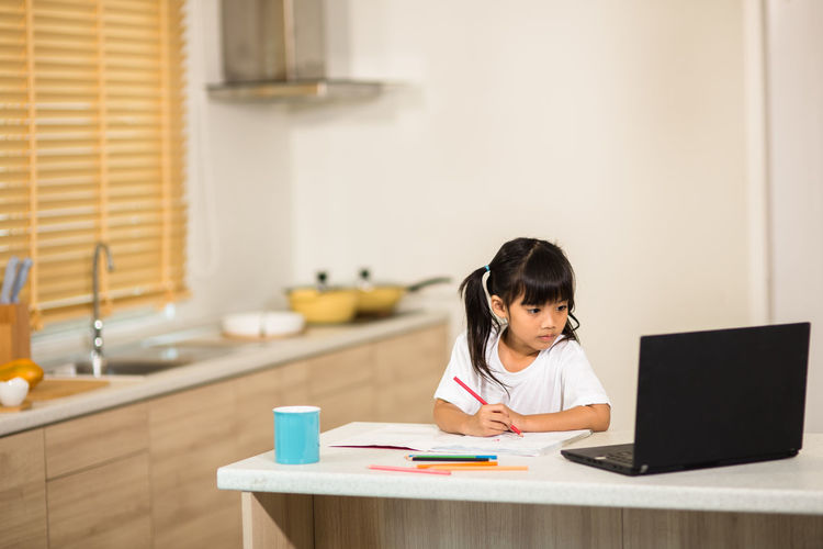 Cute girl studying at home