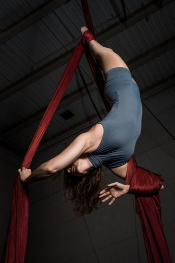 Aerial dancer woman isolated on black background Artist Circus Dance Dancing Females Hanging Out Show Woman Acrobat Aerial Artist Aerial Dancer Arts Culture And Entertainment Black Dancer Entertainment Girl One Person People Performance Performing Arts Event person Scenics Silk Women Of EyeEm Young Adult