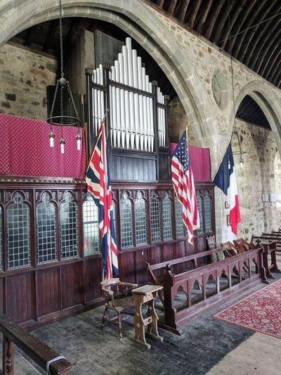 the flags in princetown church Church Organ French Flag American Flag British Flag Three Flags Patriotism History Arch Archway Building Historic Building