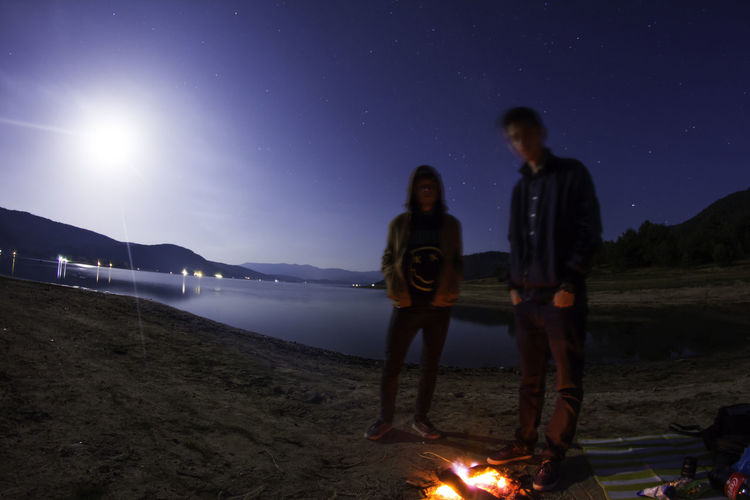 Astronomy Beach Beauty In Nature Camping Friendship Illuminated Nature Night Outdoors People Scenics Sky Space Star - Space Togetherness Two People