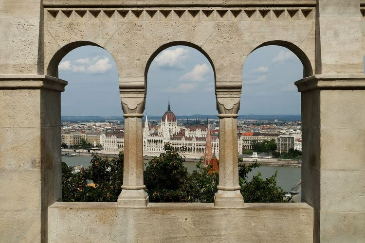 Hungarian Parliament Building Seen Through Arch Window