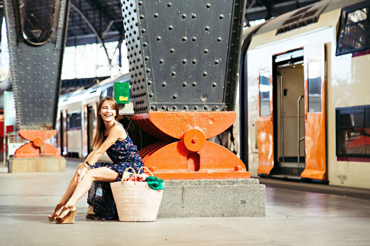 Adult Adults Only Day Full Length Lifestyles Looking At Camera One Person One Young Woman Only Outdoors People Portrait Real People Smiling Train Station Transportation Traveling Young Adult Young Women