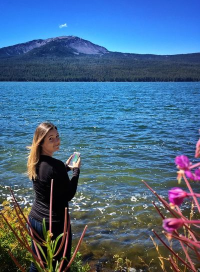 Leisure Activity Mountain Lifestyles Person Water Standing Casual Clothing Three Quarter Length Beauty In Nature Scenics Lake Nature Mountain Range Vacations Holding Young Women Long Hair Tranquility Young Adult Non-urban Scene My Daughter ♥ Internet Addiction People And Places