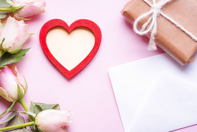 Close-Up Of Heart Shape And Flowers With Gift Box