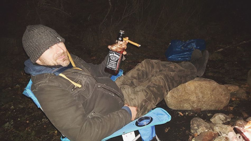 Party time during bivouac. Army Unit Military France Man Jackdaniels Hikingadventures Hiking Bivouac Campfire Cigar Whiskey EyeEm Selects Danger Weapon High Angle View Men Gun Real People Camouflage Clothing