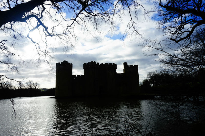 Silhouette of a castle Ancient Blue Sky Blue Sky And Clouds Bodiam Castle Branches Branches And Sky Building Exterior Built Structure Castle History Light Moat No People Old Old Ruin Outdoors Silhouette The Past Tree Trees Weather