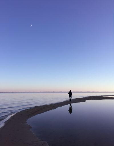 Hollow talk One Person Horizon Over Water Tranquil Scene Clear Sky Water Beauty In Nature Nature Sky Outdoors Sunset Beach Lake Sanguinet TheWeekOnEyeEM Moon Gironde France Landscape Lost In The Landscape