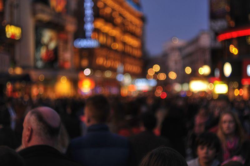 Crowd at illuminated city at night