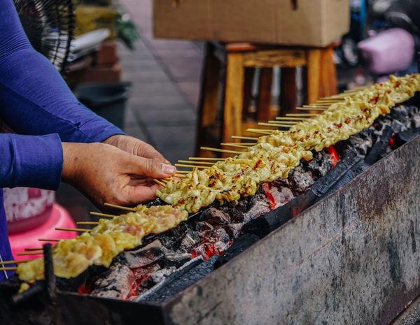 Street food satay in Bangkok, Thailand Bangkok Barbecue Barbecue Grill Food And Drink Human Hand Satay Skewer Street Food Thai Food