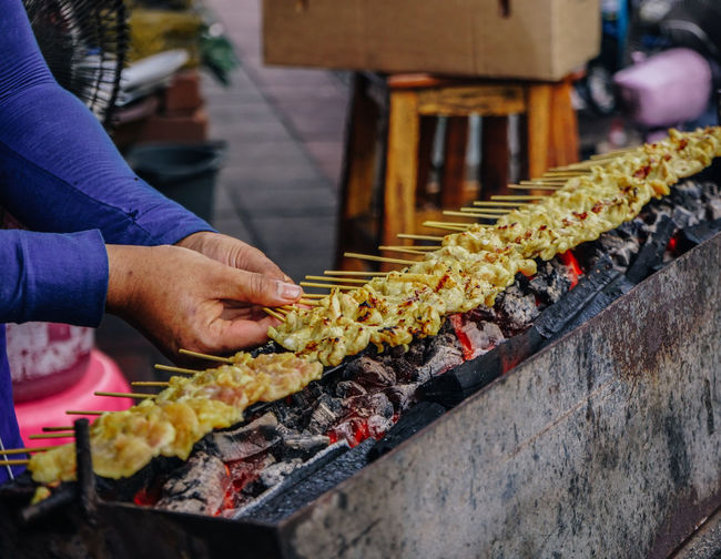 Street food satay in Bangkok, Thailand Bangkok Barbecue Barbecue Grill Food And Drink Human Hand Satay Skewer Street Food Thai Food