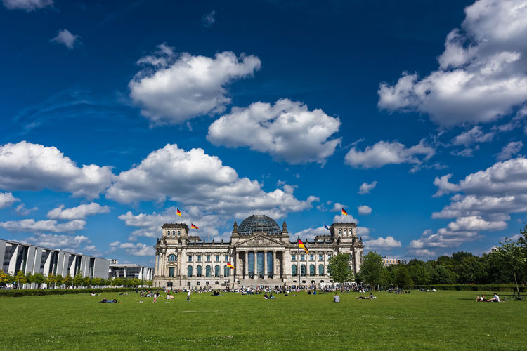 Reichstag in Berlin Architecture Battle Of The Cities Building Exterior Built Structure Bundestag City Life Cloud - Sky Dome Façade Famous Place Grass History Lawn Outdoors People And Places Reichstag Sky Tourist Travel Travel Destinations Capture Berlin