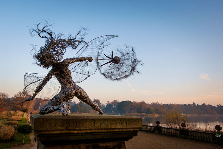 The Trentham Faries at Trentham Gardens on a cold November day as the sun set. Dandelion Fairy Faries Garden Lake Landscape Nature Outdoors Robin Wight Sculpture Sky Staffordshire Sunset Tree Trenthamfairies Trenthamgardens Winter Wire