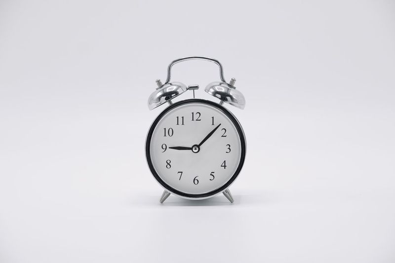 And a regular ol clock Clock Time Studio Shot Alarm Clock Copy Space White Background Indoors