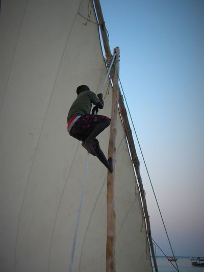 Adult African Boats Children Only Day Low Angle View Manual Worker One Person Outdoors People Rappelling Real People Working