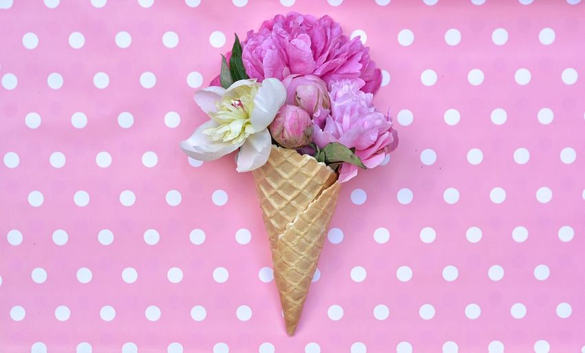 Directly Above Shot Of Peony Flowers With Ice Cream Cone On Table