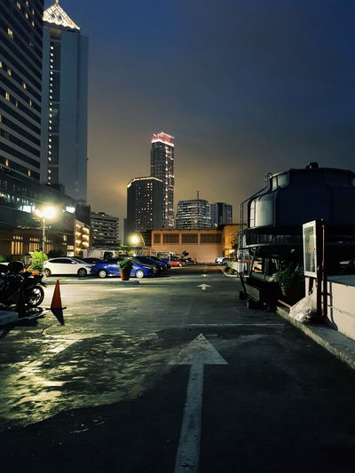 Rooftop view Dark Night Parking Street Light Car Building Perspective Office Building Cityscape Skyline Tower Tall Vehicle Urban Skyline Rainy Season Road Marking Tall - High