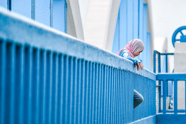 Alone Arches Blue Blue Railing Built Structure Hijab Looking Down Low Angle View Muslimah One Person Outdoors Young Woman Girl Power Long Goodbye