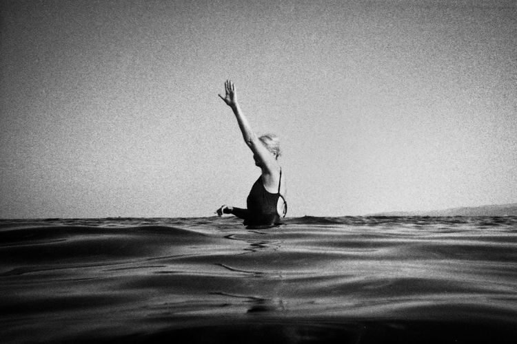 Art Beach Black And White Blackandwhite Blackandwhite Photography Casual Clothing Clear Sky Copy Space Enjoyment Fine Art Photography Full Length Horizon Over Water Leisure Activity Lifestyles Motion Nikos Pandazaras Person Rear View Sand Sea Shore Streetphotography Vacations Water Wave