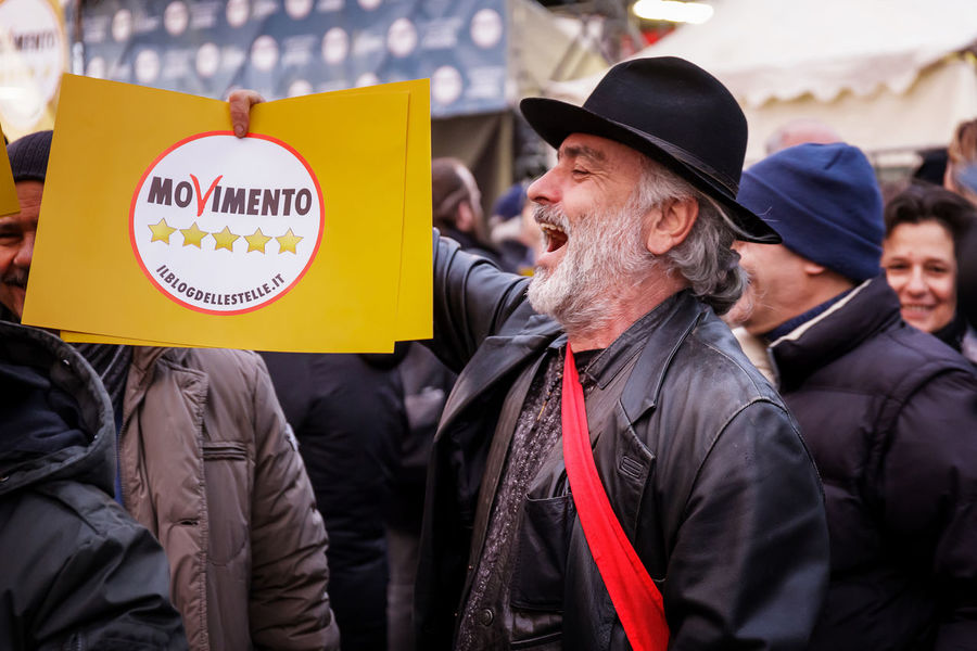 Supporters of the Five Star Movement in the square. Elezioni 2018 Protest Supporters Cinquestelle Citizens City Communication Day Fivestar Fivestars  Happiness Italy Jacket Lifestyles Men Movement Outdoors People Politics And Government Portrait Real People Senior Adult Senior Men Smiling Togetherness