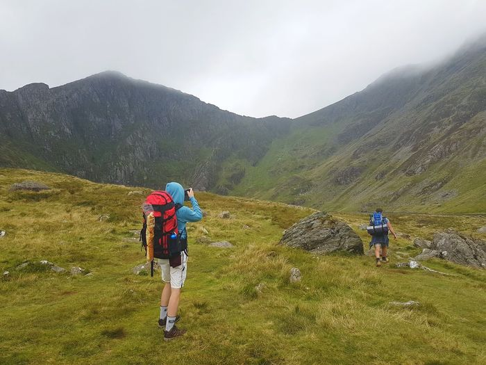 Two People Hiking Mountain People Adult Adventure Nature Day Outdoors Leisure Activity Beauty In Nature Mountain Range Landscape Vacations Scenics Men Grass Rock Scenic Mist Misty Rain Dreary Weather  Wales Llyn Cau