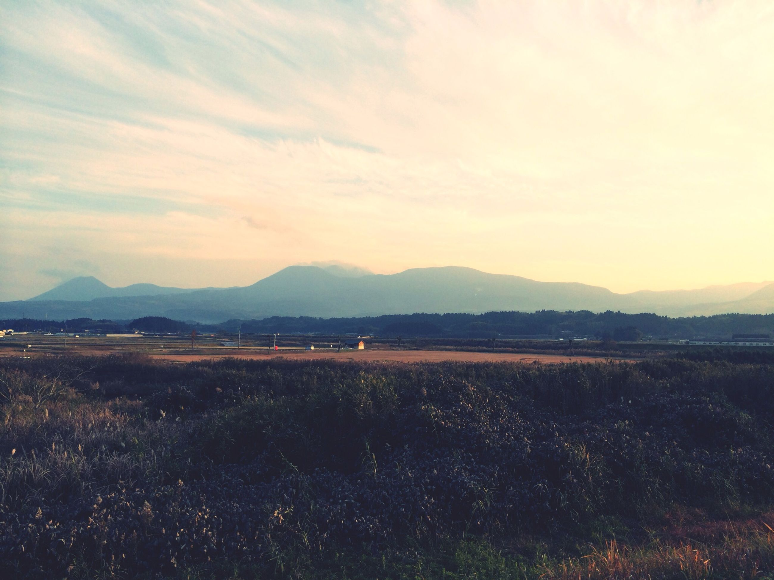 mountain, mountain range, landscape, tranquil scene, tranquility, scenics, sky, beauty in nature, nature, cloud - sky, non-urban scene, field, rural scene, idyllic, horizon over land, remote, outdoors, no people, sunset, cloud