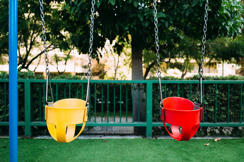 Close-up Of Baby Swings In Park
