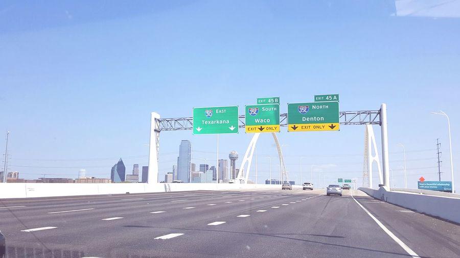 East, North, or Texas Waco, Tx Denton, Texas EyeEm Selects City Road Sign Neon Road Clear Sky Road Trip Blue Car Text Copy Space Traffic Arrow Sign