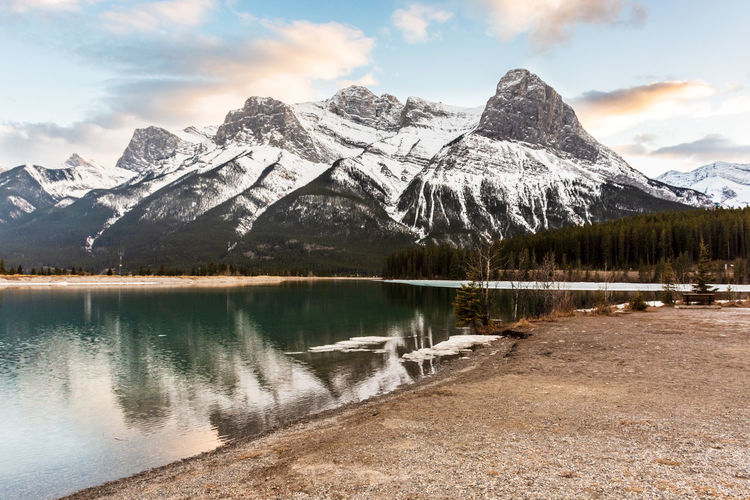 The Canadian Rockies looking majestic on a chilly Spring evening in Canmore Mountain Beauty In Nature Scenics - Nature Water Sky Snow Cold Temperature Lake Mountain Range Tranquil Scene Tranquility Reflection Snowcapped Mountain Nature Non-urban Scene Idyllic Outdoors Canadian Rockies