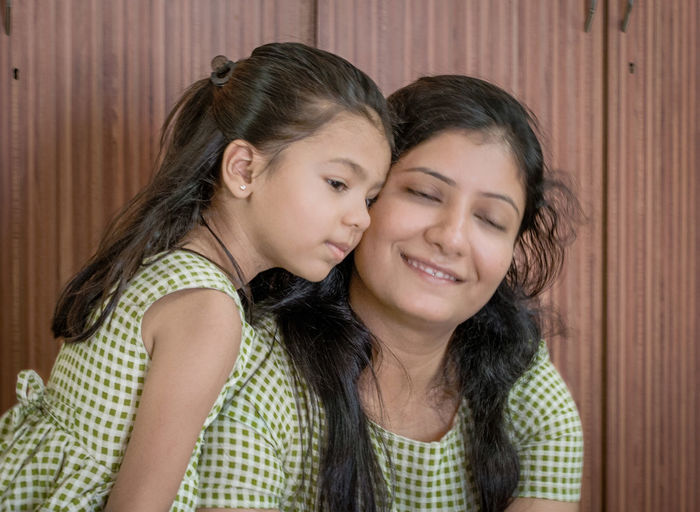 Portrait of a smiling girl with mother