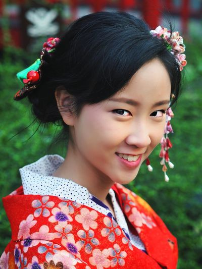 Portrait Of Smiling Woman In Traditional Clothing