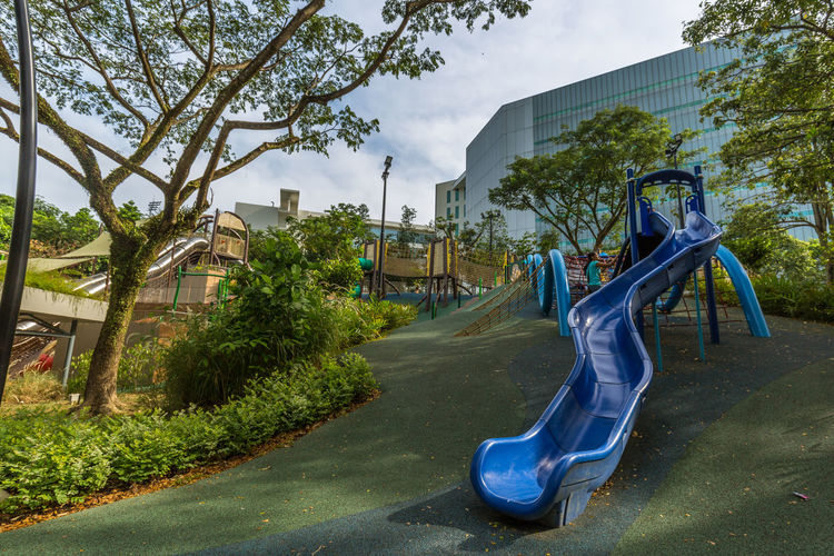 Playground - Admiralty Park. Modern loops, twirls and slides Built Structure Childhood City Day Empty Growth Nature Outdoor Play Equipment Outdoors Park Park - Man Made Space Plant Playground Sky Slide Slide - Play Equipment Tree