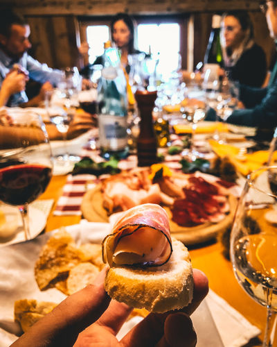Food And Drink Food Table Freshness Restaurant Real People Indoors  Business Ready-to-eat Lifestyles Group Of People Unhealthy Eating Bread Serving Size Men Women Sandwich Incidental People Indulgence Drink Temptation Meal Hand Snack Glass