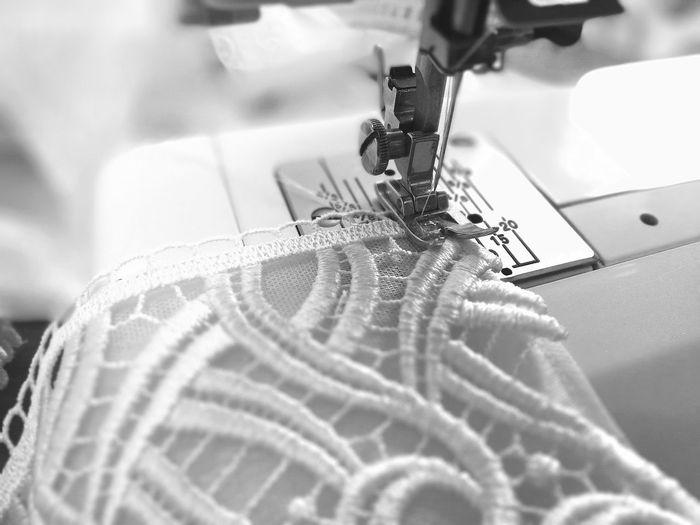 Close-Up Of Machine Stitching Cloth