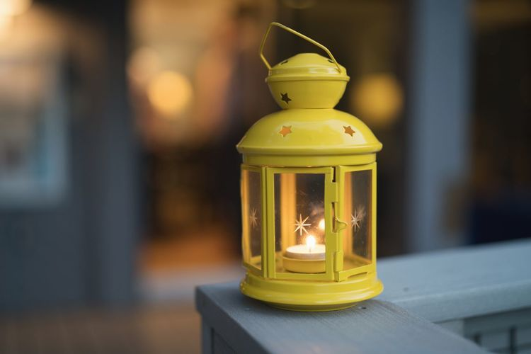 Lantern Lightning Focus On Foreground Lighting Equipment No People Close-up Lantern Yellow Single Object Indoors  Table Illuminated Architecture Nostalgia Antique Retro Styled Built Structure Metal Gold Colored The Past Electric Lamp Personal Accessory