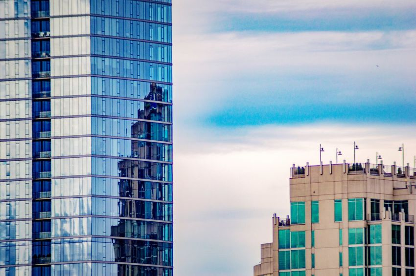 City Living High In The Sky Reflection In The Window Reflection On Building City Photography Modern Buildings Building Exterior Architecture Built Structure Building Sky City Nature Office Building Exterior Reflection Glass - Material Tower Cloud - Sky Blue