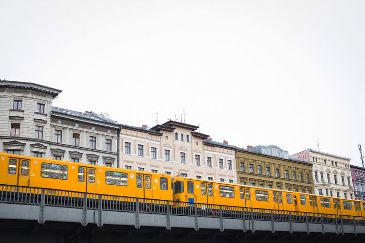 Yellow Ubahn in Berlin Architecture Berlin Building Exterior Built Structure City Clear Sky Commuter Train Day Metro Mode Of Transport No People Outdoors Public Transportation Rail Transportation Sbahn Sky Train Train - Vehicle Transportation Ubahn Windows Yellow Yellow Train
