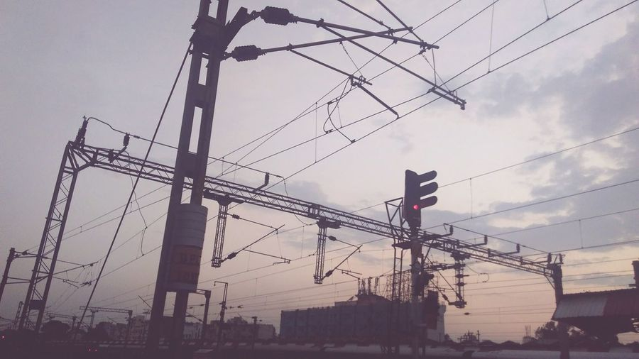AlongTheWay Railway Track Railway Station Sky Electricity  Technology Electricity Pylon Industry Fuel And Power Generation Cable Power Line  Outdoors Machinery Connection