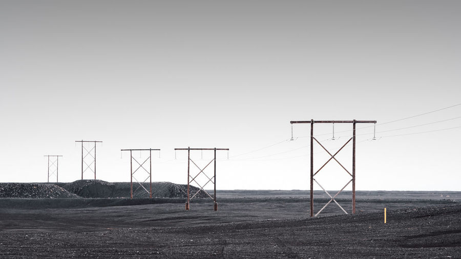 electricity pylon on field against clear sky Fine Art Photography Iceland Iceland Landscape Cable Clear Sky Connection Copy Space Copy Space In Sky Day Electricity  Electricity Pylon Environment Field Fine Art Fineart Fuel And Power Generation Iceland Trip Land Landscape Minimalism Muted Colors Nature No People Outdoors Philipp Dase Power Line  Power Supply Sky Technology Tranquility
