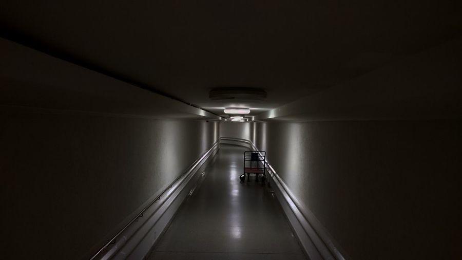 Trolley in illuminated corridor of building