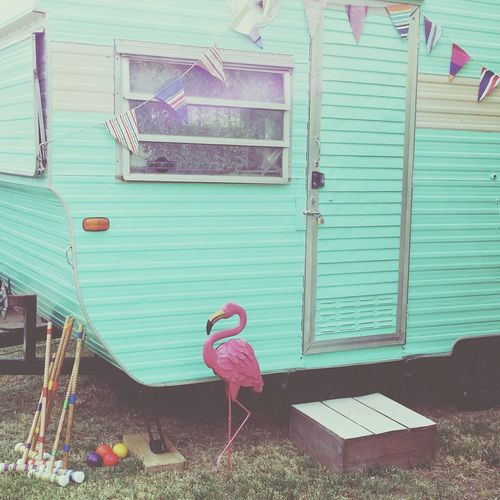 Pastel Power Vintage Caravan Vintage Vintage Style Caravan Trailer Pastel Green Mint Green Flamingo Croquet Yard Games Hipster NOMAD Nomadic Life Outdoors Bunting Multicolor Pastel Pink Pastel Paint Retro Summer Days