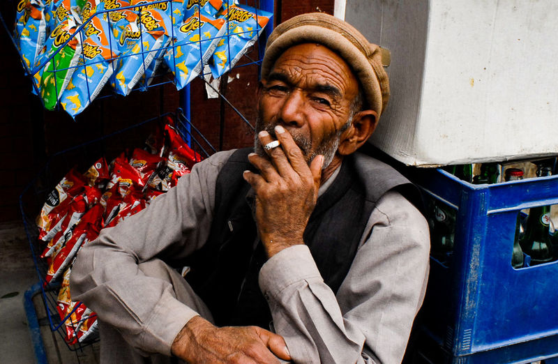 """""""Cant quit smoking because i am addicted to has ruined my life, but its very hard to quit."""" Pakistani Traveller Skardu Pakistan Smoking The Photojournalist - 2018 EyeEm Awards Adult Beard Cigarette  Facial Hair Front View Looking Men Old Age Old Man Portrait One Person Portrait Potraiture Real People Senior Adult Sitting Smoking - Activity Tired"""
