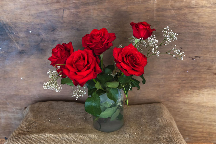 Beautiful bouquet of red roses on rustic background with copy space. Romantic concept. Flower Plant Table Indoors  Rosé Freshness Nature Vase Red Rose - Flower Fragility Close-up No People Petal Bouquet Bunch Of Flowers Red Background Wallpaper Copy Space Romantic Romance Valentinesday Couple Wedding