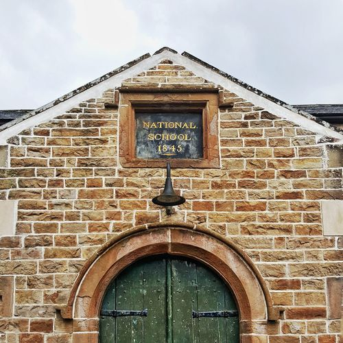 School building 1845 Door Historic Doors Education Dent Yorkshire Yorkshire Dales School 1845 Politics And Government Clock Face Façade Police Station Entrance Door Sky Architecture Building Exterior Built Structure Historic Palace Closed