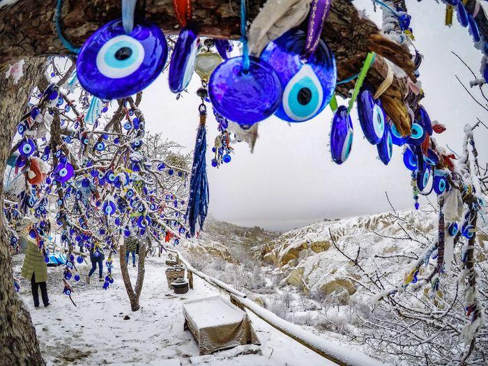 Evil eye tree in Cappadocia, Turkey Turkey Cappadocia Göreme Beads Tree Medusa Evil Eye Snow Hanging Blue Outdoors Day No People Multi Colored Nature Shades Of Winter EyeEmNewHere