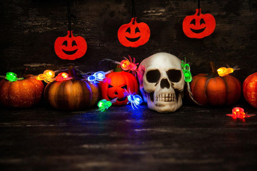 Celebration Halloween Pumpkin Food And Drink Food Jack O' Lantern Spooky Holiday - Event Decoration Fear Face Human Skeleton Group Of Objects Anthropomorphic Face Horror No People Illuminated Lighting Equipment Dark